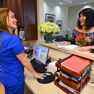 Rhonda holding jovial rapport with pleased patient