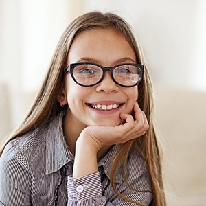 Smiling young girl wearing glasses