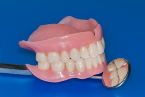 Dentures and dental mirror