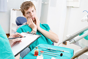 Man in pain in the dental chair.