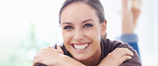 Woman sharing healthy smile after periodontal therapy