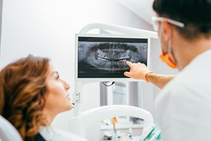 Patient and dentist looking at x-rays